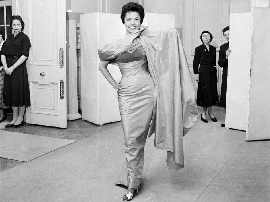 Lena Horne, the sultry American singer who appeared in several musicals in the '40s and was a regular of the Cotton Club, trying on a dress May 4