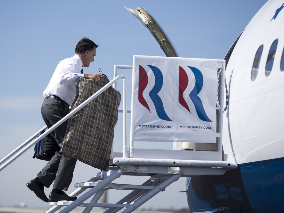 Republican presidential nominee Mitt Romney boards his campaign plane Thursday in Dayton, Ohio, for a flight to North Carolina. In comments to <em>The Columbus Dispatch</em>, Romney said uninsured Americans don't die from a lack of health care.