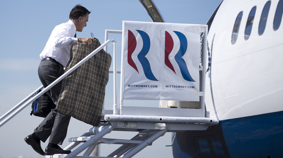 Republican presidential nominee Mitt Romney boards his campaign plane Thursday in Dayton, Ohio, for a flight to North Carolina. In comments to The Columbus Dispatch, Romney said uninsured Americans don't die from a lack of health care. (AP)