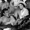 Andy Griffith playing guitar as Patricia Neal watches in a scene from the Elia Kazan's A Face In The Crowd.