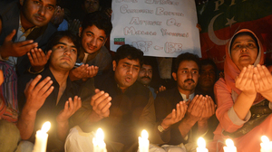 Supporters of the political party Pakistan Tehreek-e-Insaaf pay tribute to Malala in Islamabad on Wednesday.