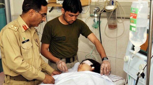 Malala Yousafzai is treated in a hospital in Peshawar, Pakistan, after she was shot on Tuesday. (EPA/Landov)