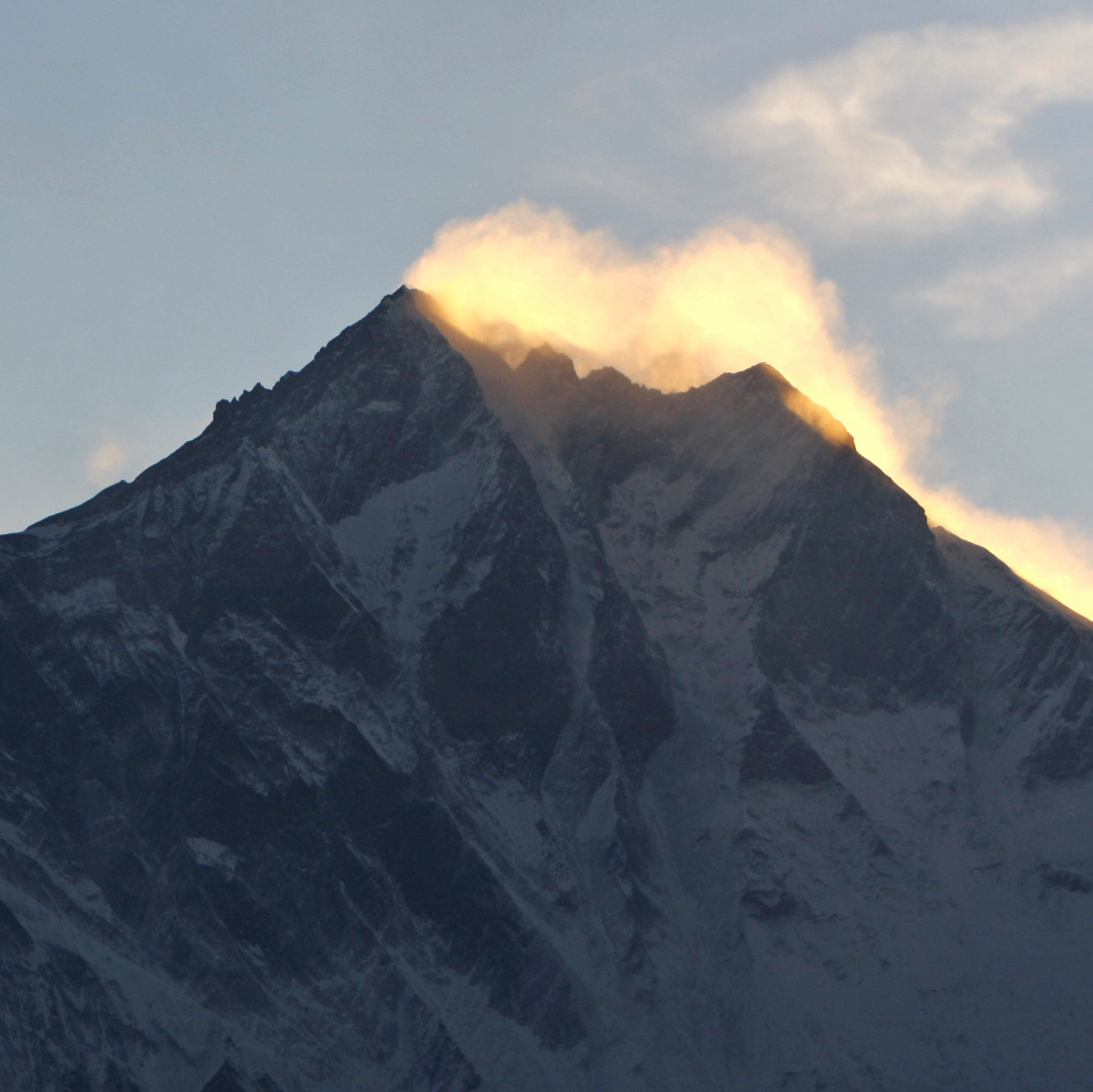 Clouds hover above the world's highest peak Mount Everest (left) and Mount Lhotse in Nepal.