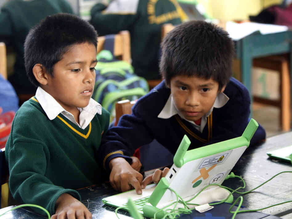 Students use a laptop at the Jose Maria public school in a shantytown on the outskirts of Lima, Peru on June 8. Peru has sent more than 800,000 laptop computers to children across the country, one of the world's most ambitious efforts to leverage digital technology in the fight agai