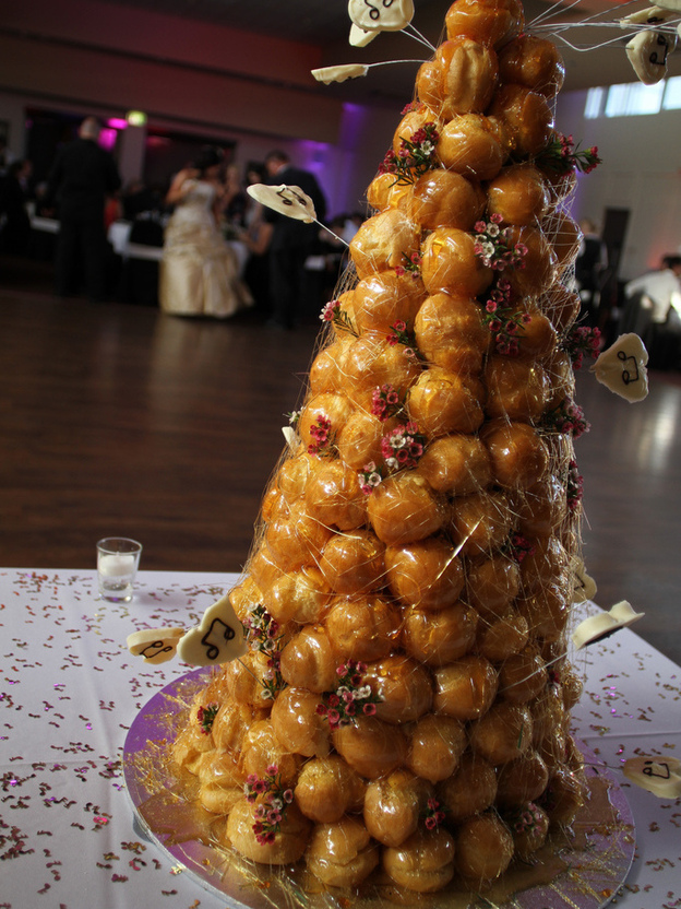 A tower of profiteroles like this one, known as croquembouche, was created in France to celebrate Maillard, the man credited with identifying a key reaction in food science.