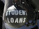 Gan Golan holds a ball and chain representing his college loan debt during at a Occupy DC event last year.