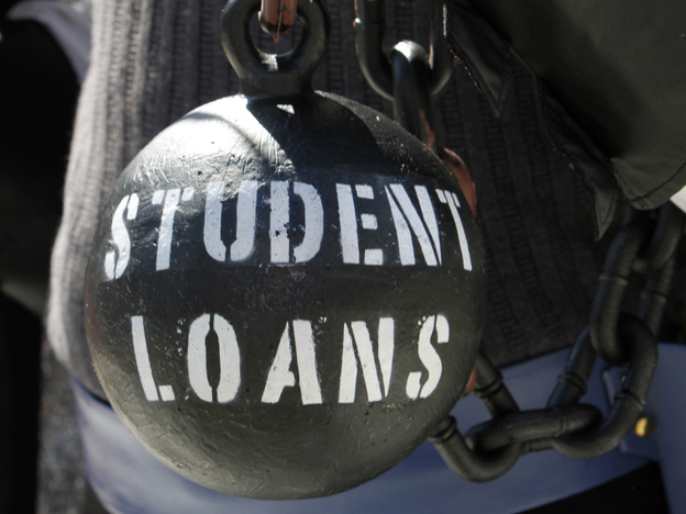 Gan Golan holds a ball and chain representing his college loan debt during at a Occupy DC event last year. (AP)