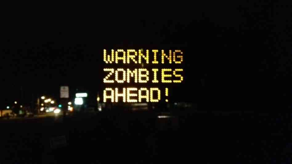 "A Portland, Maine road sign is changed to a zombie warning on Wednesday, Oct. 10, 2012. It originally read ""Night work 8 pm-6 am. Expect delays."""