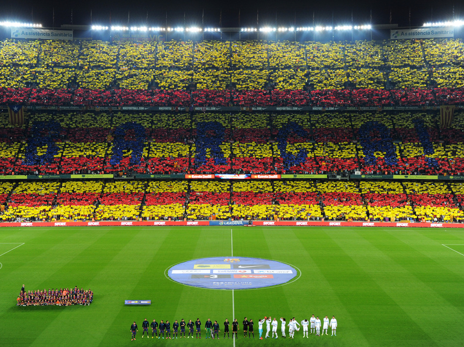 Fans of FC Barcelona form a Catalan flag in the stands before the start of a match between Barcelona and archrival Real Madrid in Barcelona earlier this month. (Getty Images)