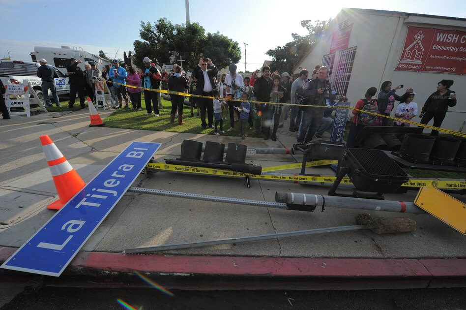 In order to move the shuttle through the streets, trees had to be cut and signs and street lights had to be removed. (AFP/Getty Images)