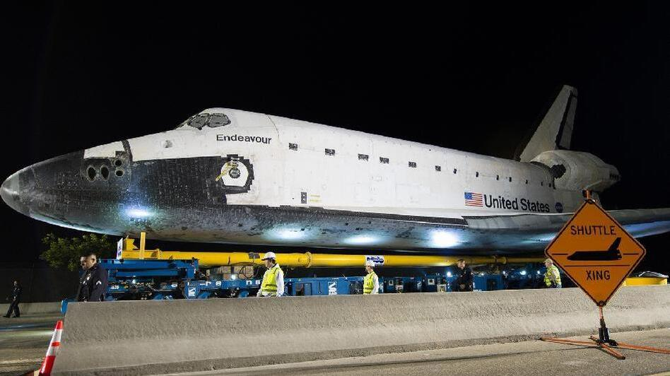 The space shuttle Endeavour is seen atop the Over Land Transporter after exiting the Los Angeles International Airport on its way to its new home at the California Science Center in Los Angeles (NASA)