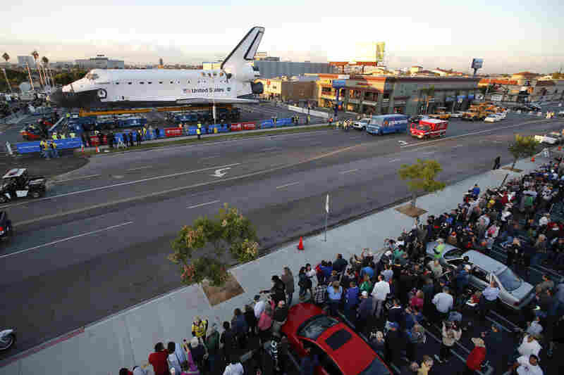 Spectators gather to watch the space shuttle Endeavour in Los Angeles on Friday. Endeavour's 12-mile road trip kicked off shortly before midnight Thursday as it moved from its Los Angeles International Airport hangar en route to the California Science Center, its ultimate destination.