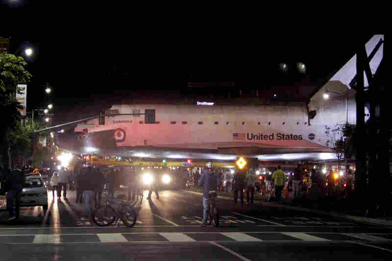 The space shuttle Endeavour leaves Los Angeles International Airport hangar for the streets of Los Angeles in the early morning.