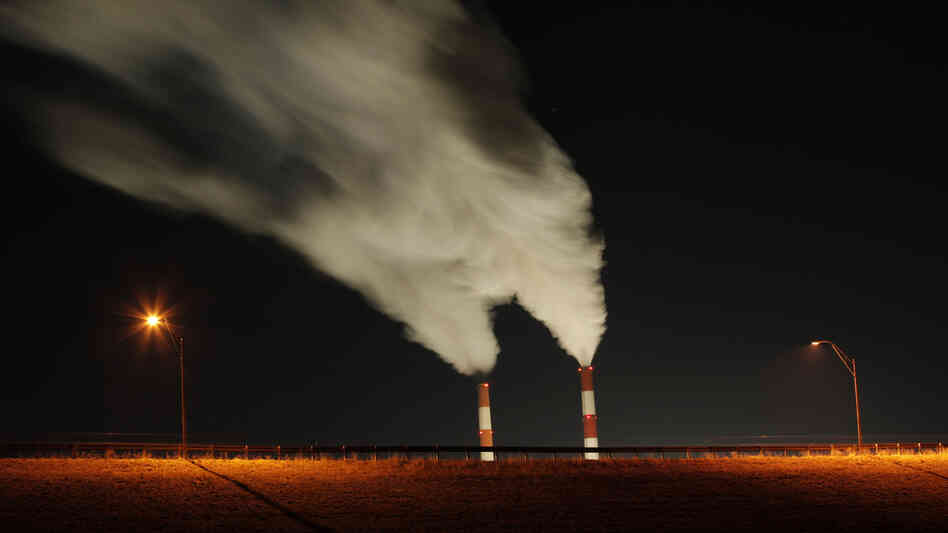Smoke rises from the stacks of the La Cygne Generating Station coal-