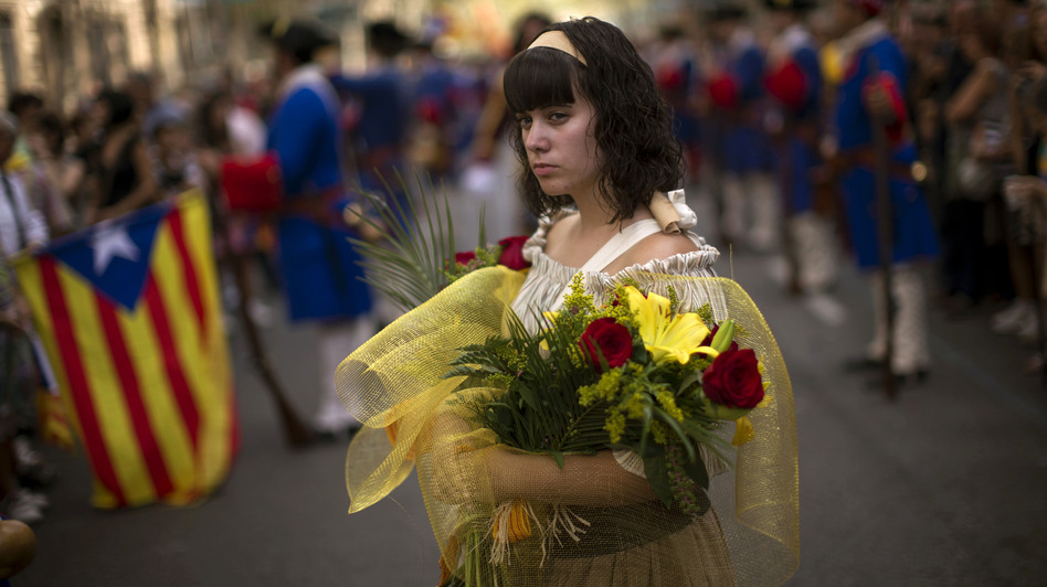 A woman in traditional Catalan dress participates in National Day demonstrations in Barcelona on Sept. 11. (AP)
