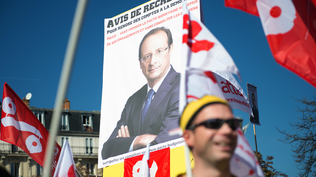 Just a few months ago, supporters rallied in the streets for the election of Francois Hollande. Now, some of the same people are protesting against the French president. Leftist parties and unions organized this anti-austerity protest in September. (AFP/Getty Images)