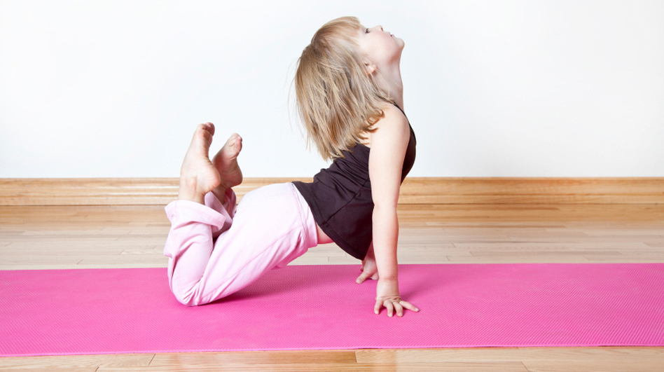 Yoga is increasingly being used in classrooms across the U.S. to help kids behave and perform better in school. (iStockphoto.com)