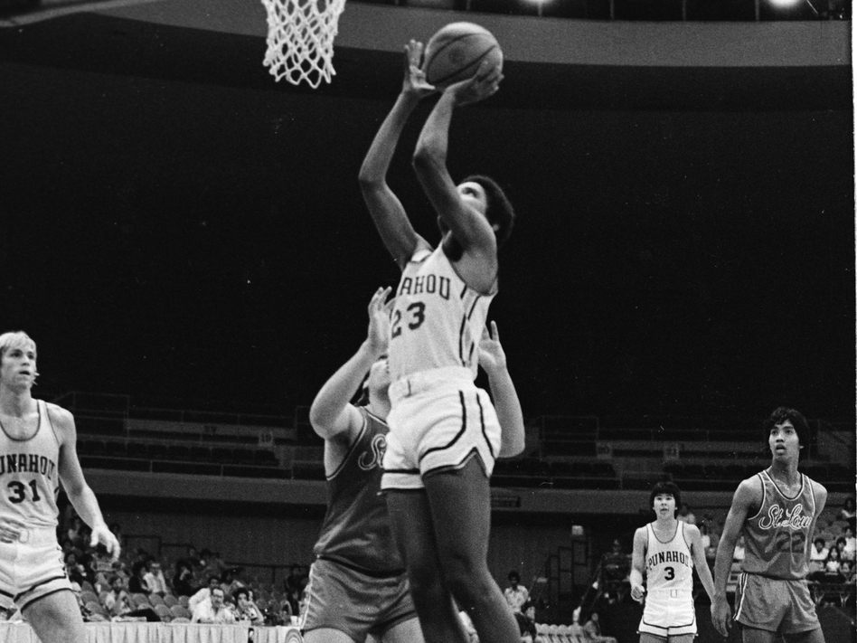 Obama shoots the ball while playing for the Punahou School basketball team in 1979. (Getty Images)