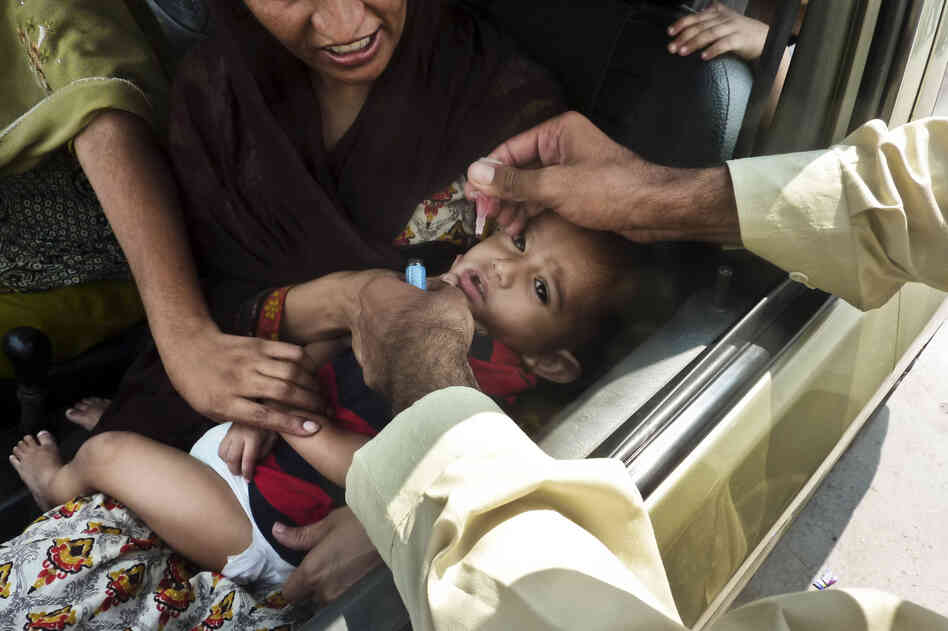 A child is inoculated with the polio vaccine at a traffic checkpoint just outside Pakistan's capital, Islamabad. Last year, Pakistan had the highest number of polio cases — 198.
