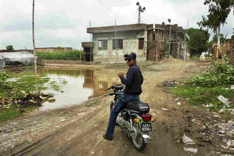 Social mobilizer Omer Feroze makes his way through a Lahore slum as part of an effort to educate people about polio and dispel any rumors about the vaccine. Misconceptions about the vaccine are rife within the country's population.