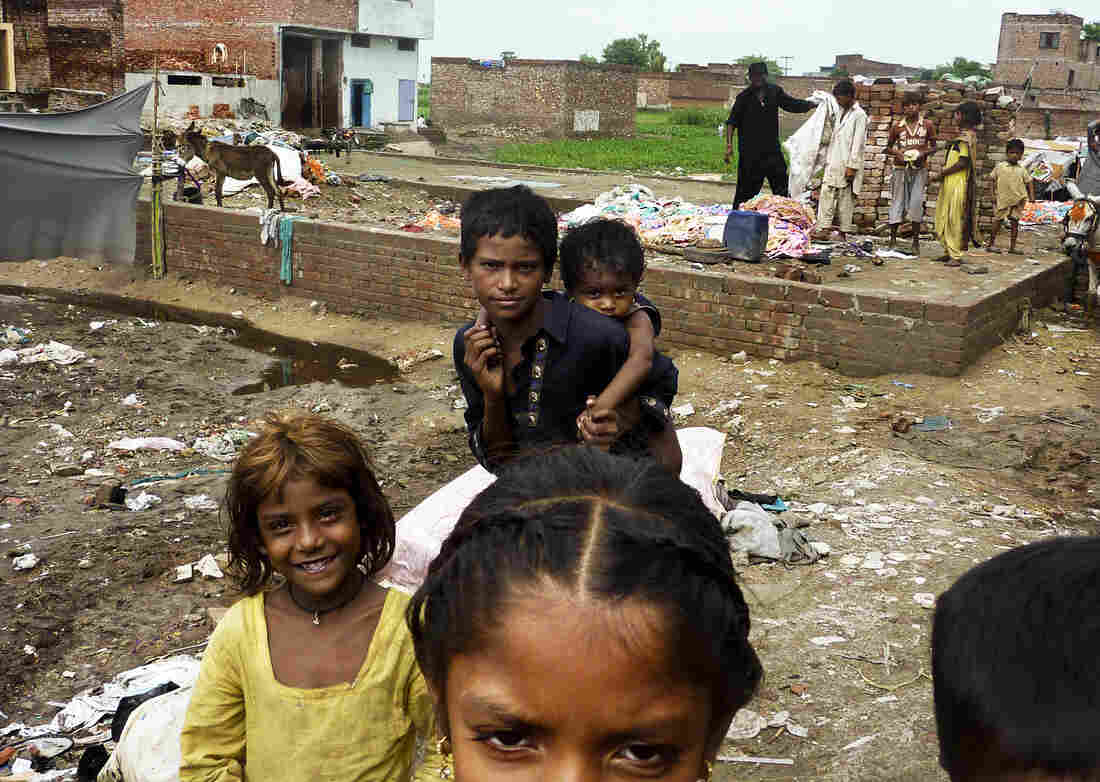 Children in a Lahore slum after heavy rains. The slum has a large population of Pashtuns who came from Pakistan's lawless tribal regions; many carry the polio virus with them.