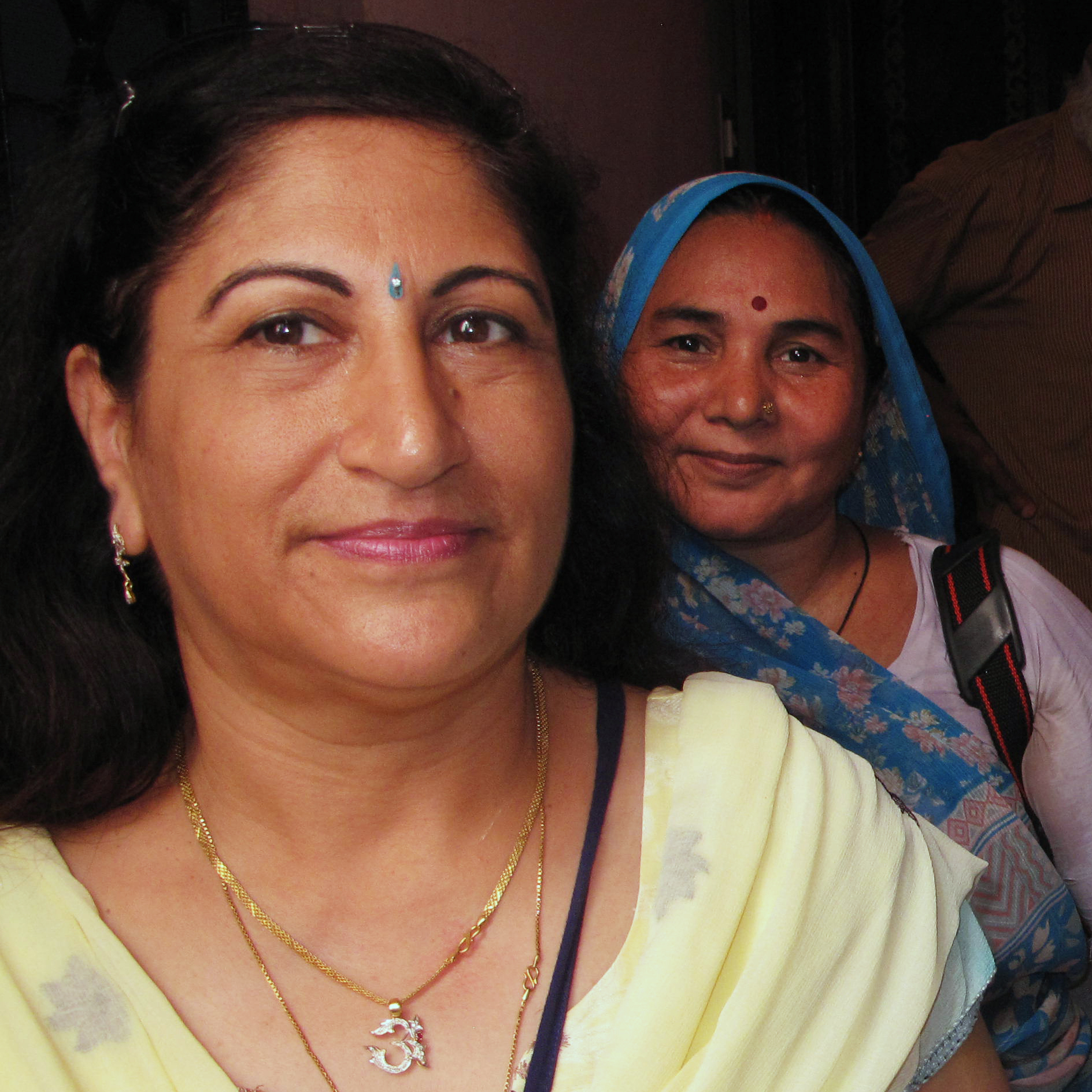 Dr. Kiran Kathuria (left) and veteran volunteer Santosh Sharma (front right) make the rounds with a team of vaccinators in Nehru Nagar, a middle-class area of Delhi. India's nationwide polio eradication program, begun in 1995, was modeled after Delhi's.