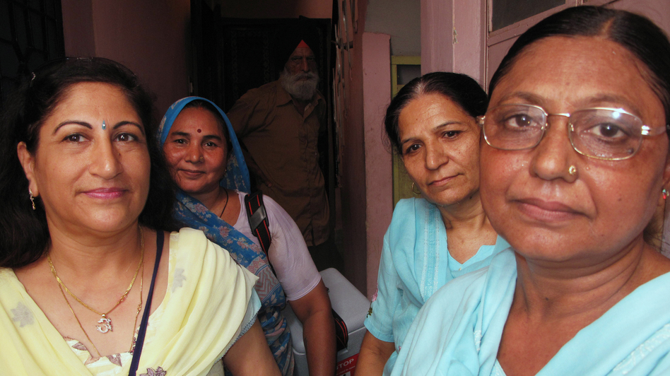 Dr. Kiran Kathuria (left) and veteran volunteer Santosh Sharma (front right) make the rounds with a team of vaccinators in Nehru Nagar, a middle-class area of Delhi. India's nationwide polio eradication program, begun in 1995, was modeled after Delhi's. (NPR)