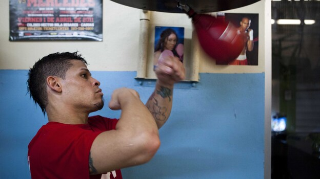 Boxer Orlando Cruz hits a speed bag at a public gym in San Juan, Puerto Rico, on Oct. 4. He said publicly that he is gay earlier this month. (AP)