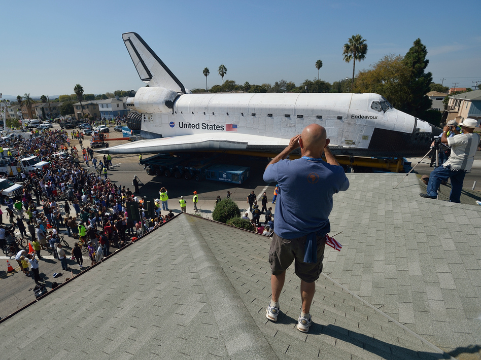 Space shuttle Endeavour travels through Los Angeles on Saturday.