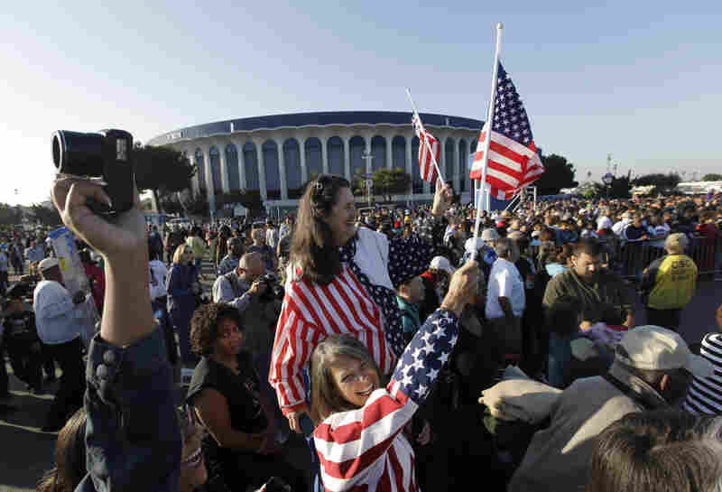 On Friday, the shuttle made a late-morning pit stop at the Forum, where it was greeted in the arena's parking lot by a throng of cheering spectators.