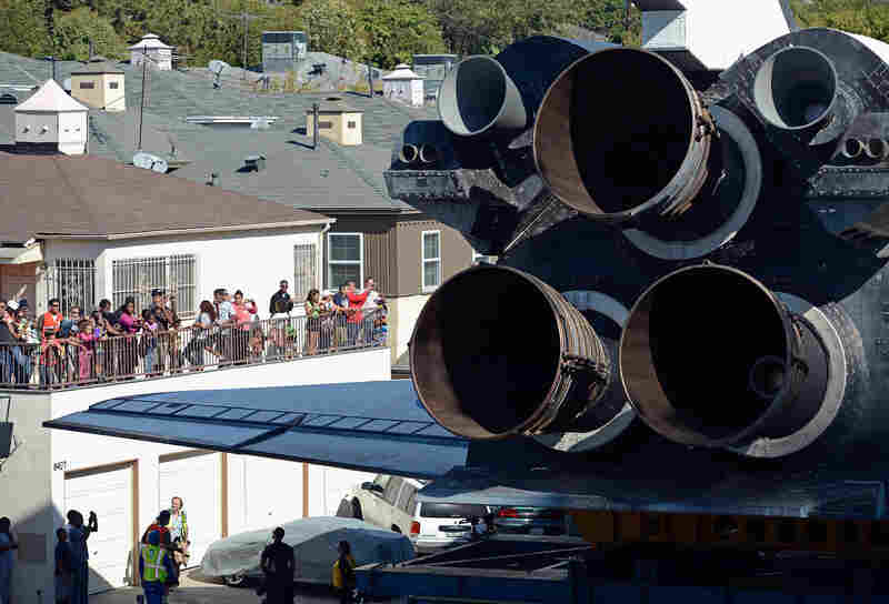 Along the 12-mile course, people marveled at the engineering. Some rooted for Endeavour when it appeared it might clip a lightpost. Others wondered if it could just hurry up to its destination.