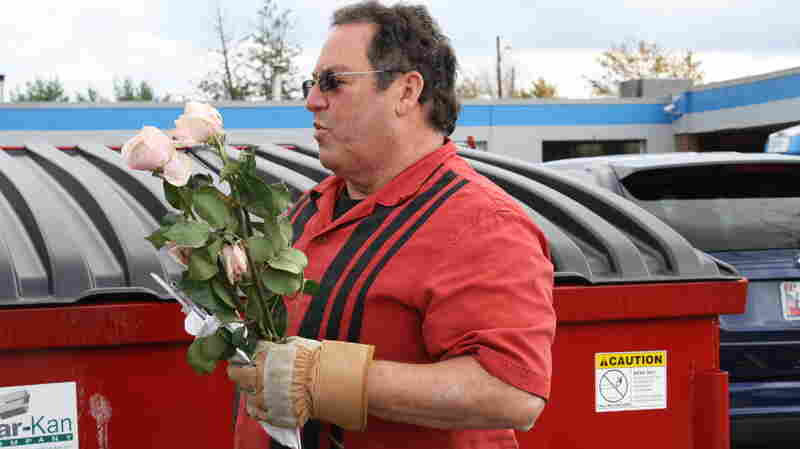 Roy gets his wife some flowers out of the dumpster on Extreme Cheapskates.