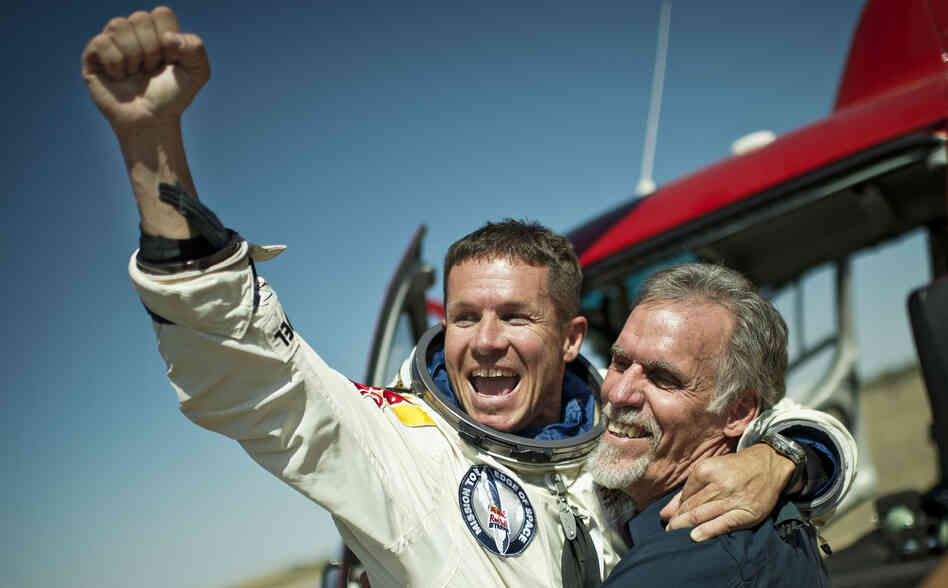 Pilot Felix Baumgartner of Austria and technical project director Art Thompson celebrate after Baumgartner completed a skydive from the stratosphere Sunday.
