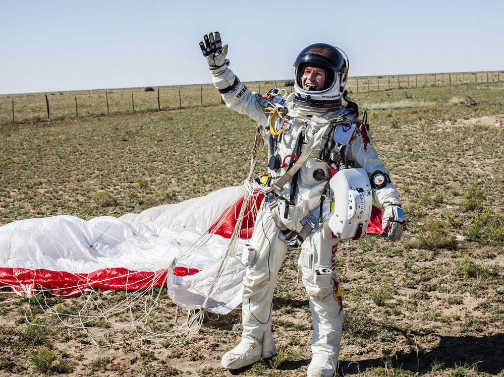 Pilot Felix Baumgartner of Austria celebrates after successfully jumping 24 miles from the stratosphere in Roswell, N.M., Sunday.