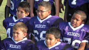 The Angleton Wildcats pose for picture day. The team of 7- and 8-year-olds is from the south Texas town of Angleton.