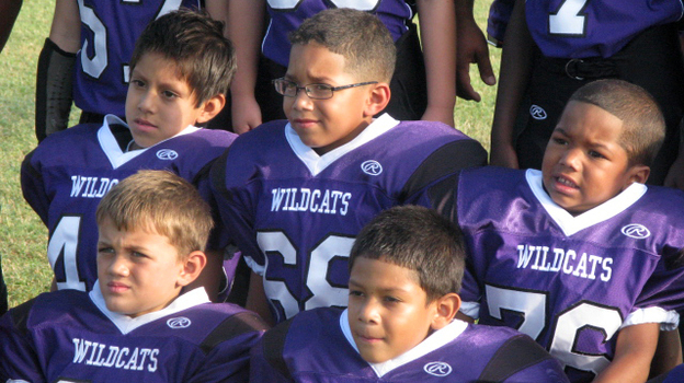 The Angleton Wildcats pose for picture day. The team of 7- and 8-year-olds is from the south Texas town of Angleton. (NPR)