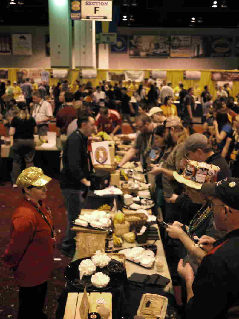 Festival goers line up for cheese between beer tastings. Many people arrive at the festival wearing necklaces hung with pretzels to munch on.