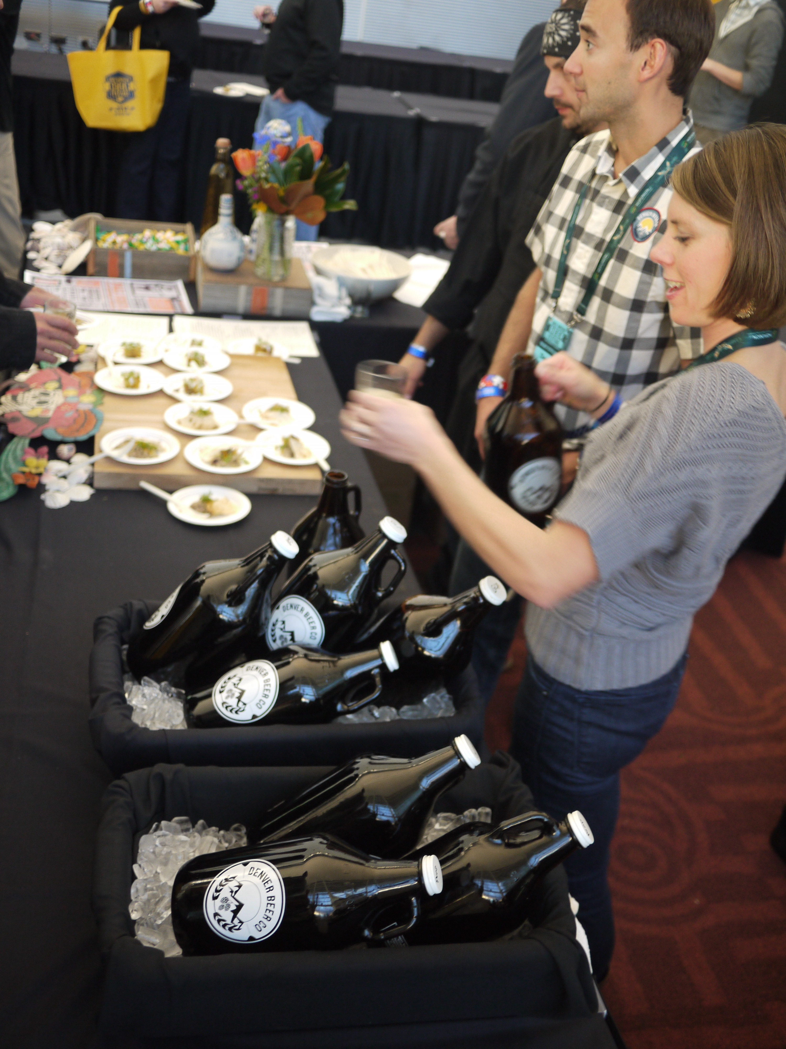 The Denver Beer Company's tasting table featured growlers of its pumpkin beer and graham cracker porter.