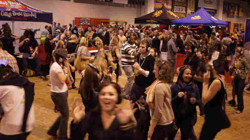"Taking a break from beer, festival attendees dance at a ""Silent Disco"" put on each year by Colorado brewery Oskar Blues."