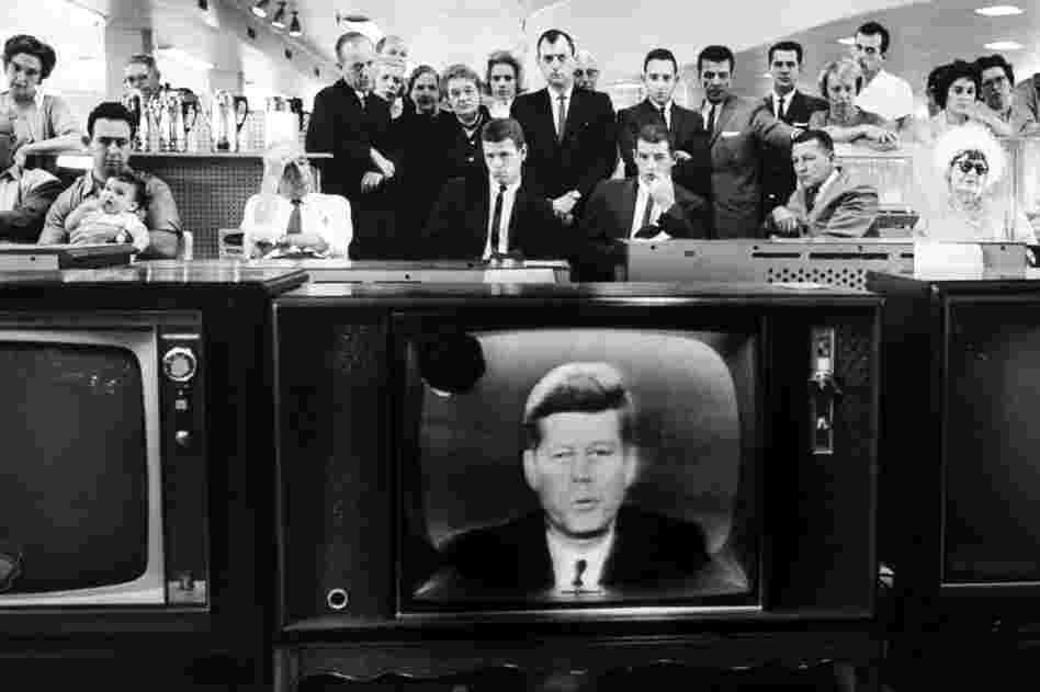 President John F. Kennedy gives his TV announcement of the Cuban blockade during the missile crisis in a department store in California in October 1962.