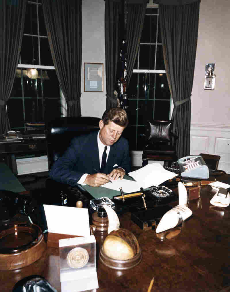 Kennedy signs the Cuba Quarantine Proclamation Oct. 23, 1962, in the Oval Office.