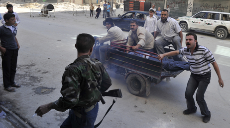 Syrians deliver an injured civilian to a hospital in the northern city of Aleppo on Saturday, following shelling by government forces.