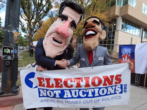 Costumed demonstrators on Oct. 3 in Denver, before the first presidential debate.