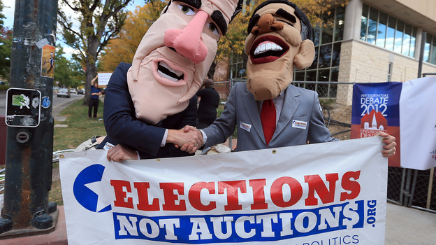 Costumed demonstrators on Oct. 3 in Denver, before the first presidential debate. (Getty Images)