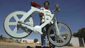 Israeli inventor and his cardboard bicycle.