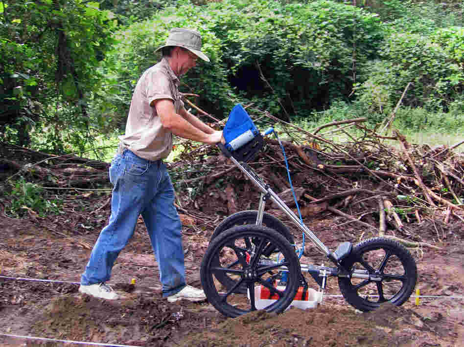 Using ground penetrating radar, archaeologist Richard Estabrook has identified dozens of previously unknown graves at the school's cemetery.