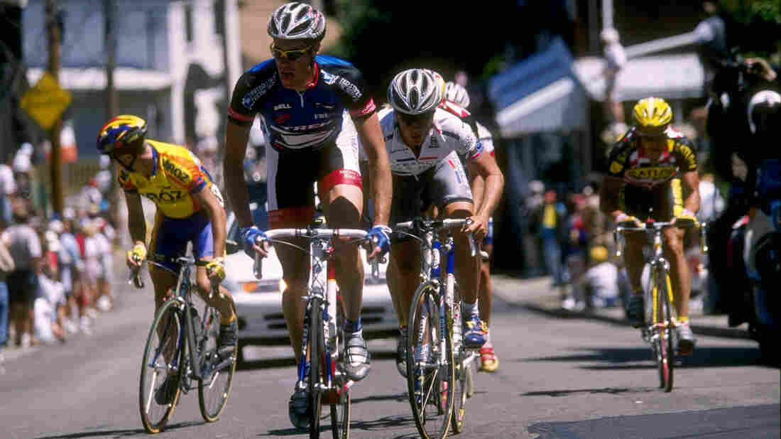 Former cyclist Scott Mercier has gained notoriety for refusing to go on a doping program 15 years ago. Here, Mercier (in blue jersey) rides just ahead of cyclist Chris Horner in 1997.