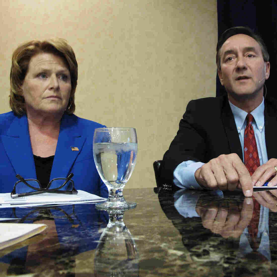 Democratic Senate candidate Heidi Heitkamp and her Republican opponent, Rep. Rick Berg, attend a North Dakota Chamber of Commerce forum in Bismarck last week.