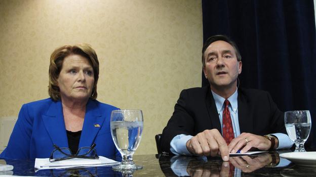 Democratic Senate candidate Heidi Heitkamp and her Republican opponent, Rep. Rick Berg, attend a North Dakota Chamber of Commerce forum in Bismarck last week. (AP)