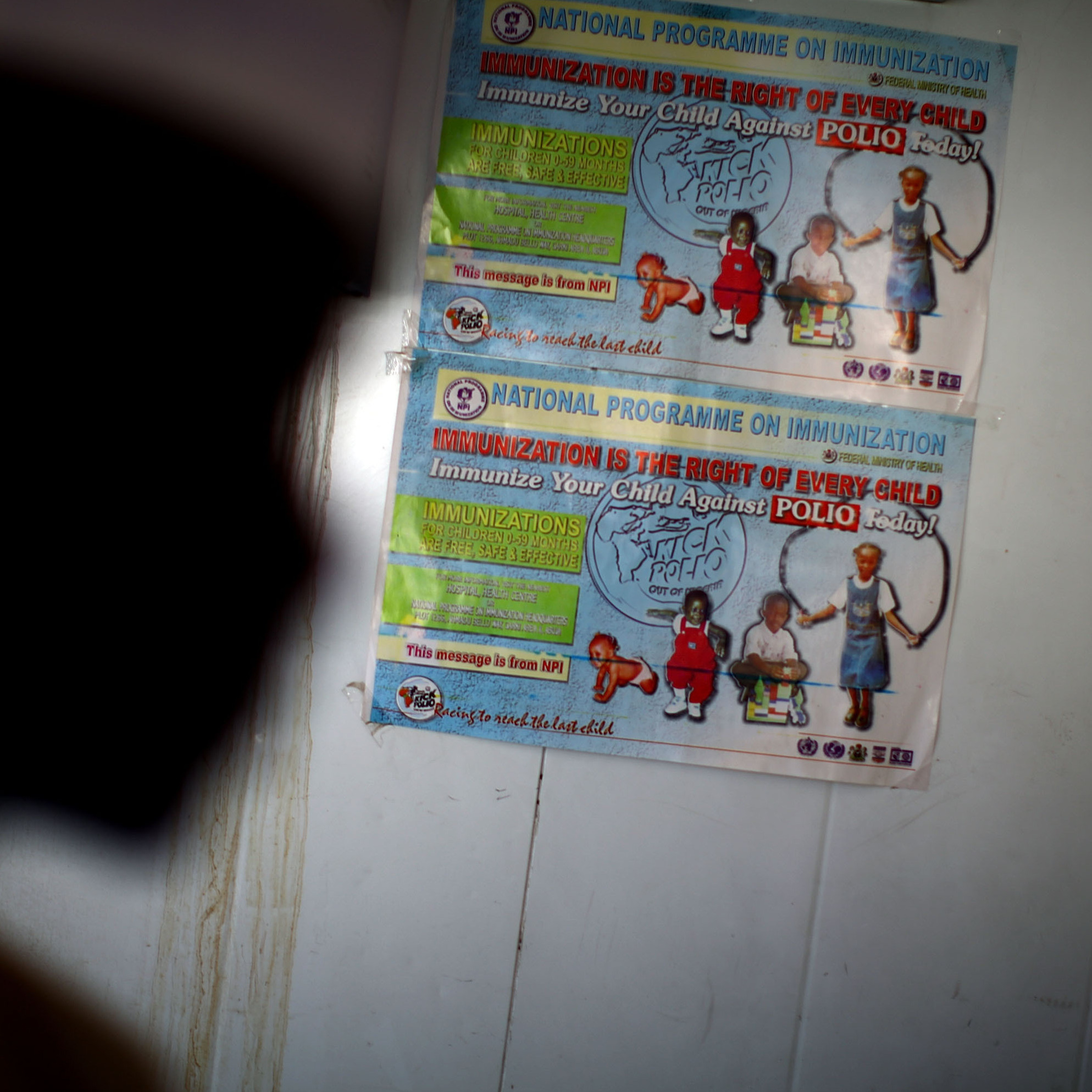 A polio immunization poster is taped on a walk-in refrigerator at a new cold storage facility at a hospital in Kano. The oral polio vaccine must be kept refrigerated; that's been a challenge in a place with only intermittent access to electricity.